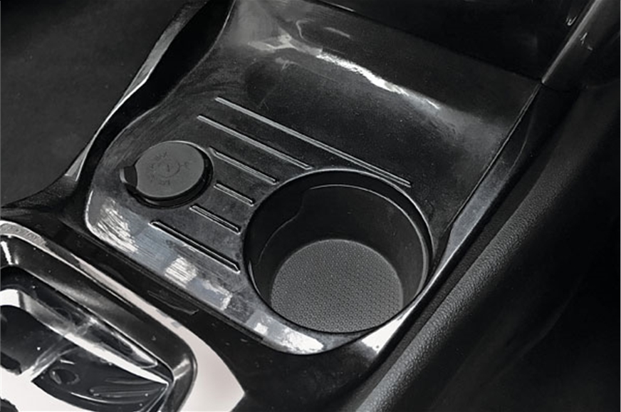 A solitary cupholder in the centre console simply isn't e...