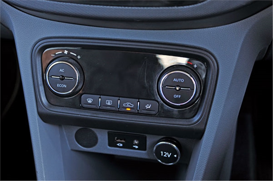 Tigor gets auto climate control. Blank space between knob...