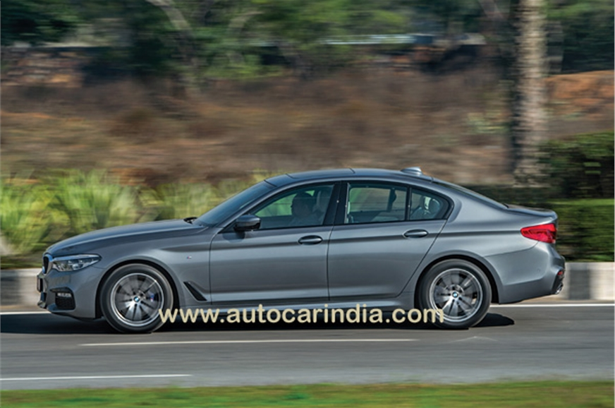 The new 5 has a more coupé-like roof, and the flick of th...