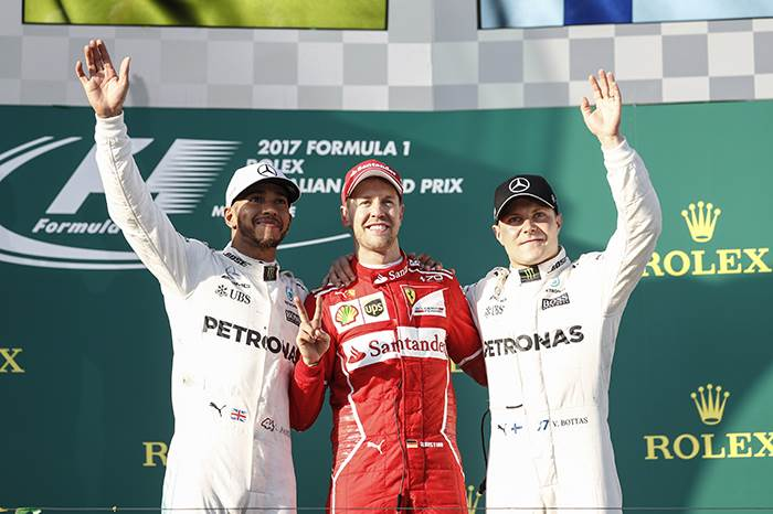 Australian GP: Vettel jumps Hamilton for first 2017 win