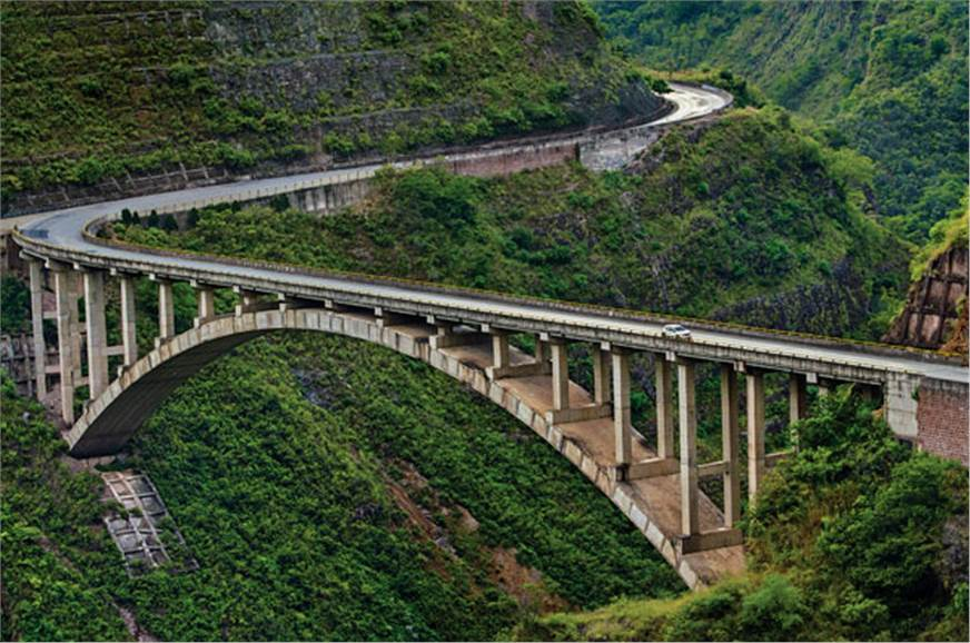 This section of highway in the Sichuan province can withs...