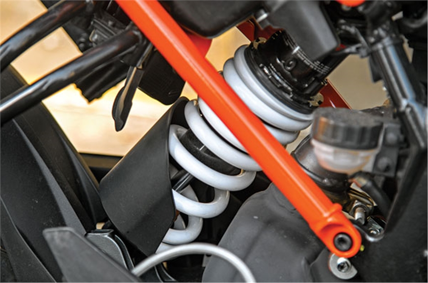 Rear monoshock gets small plastic protection unit to keep...