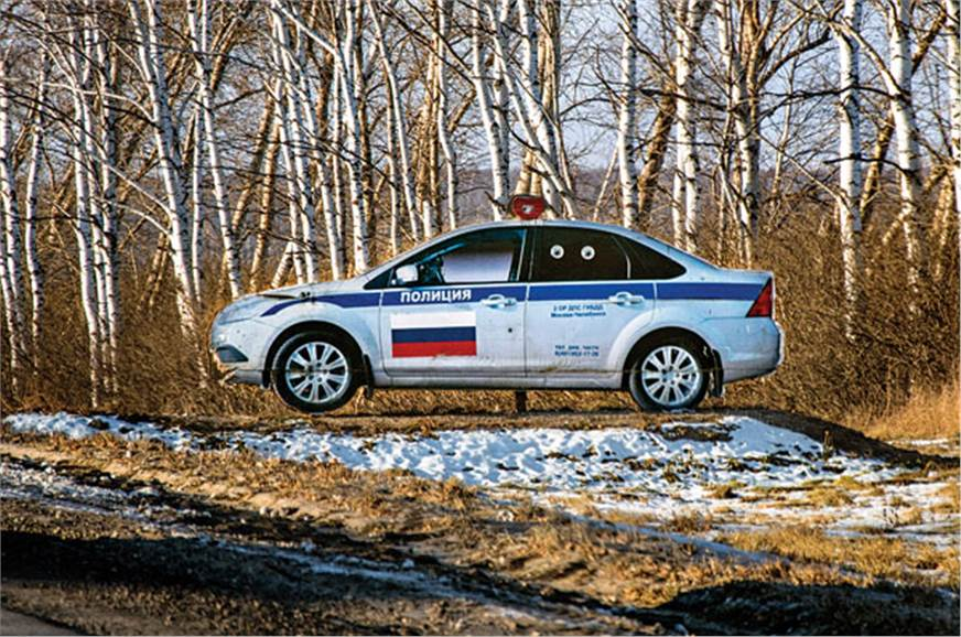 Cut-outs of police cars on Russia's highways a reminder t...