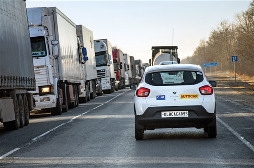 The light Kwid had to share space with massive trucks on ...