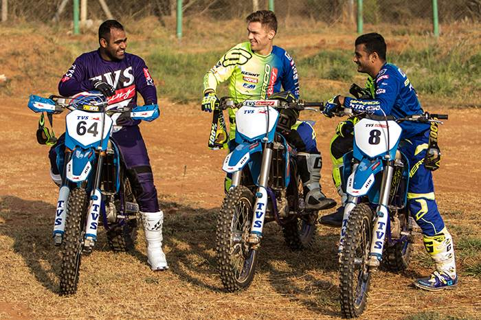 Abdul Tanveer (left) and Aravind KP (right) with TVS-Sherco's French rider Adrien Metge