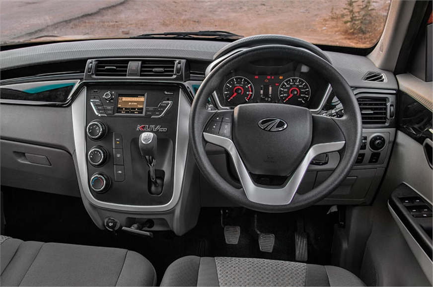 KUV dash is smart. Gear lever sits on centre console to m...