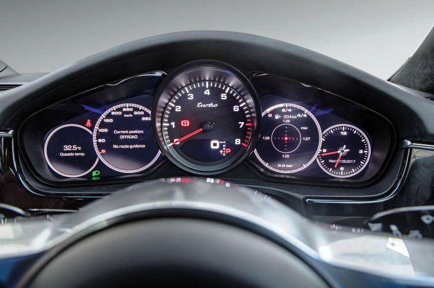 Traditional Porsche five dials; tacho is analogue flanked...