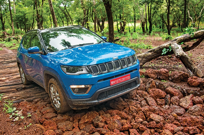 Jeep's Compass crawled over slippery and loose rocks with...