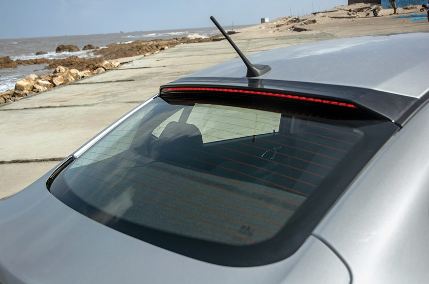 LED stop light panel artfully integrated into the roof sp...