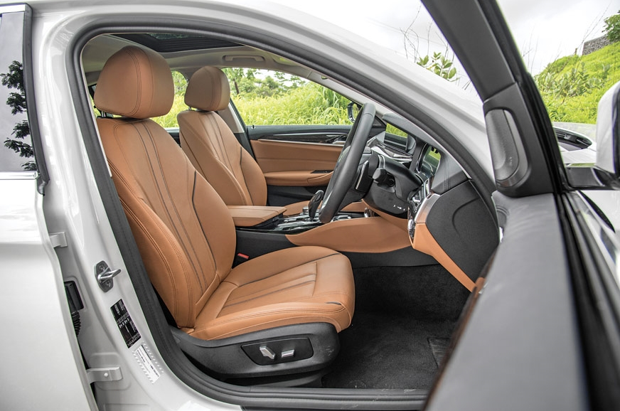 The 5-series' front seats are comfy but have very little ...