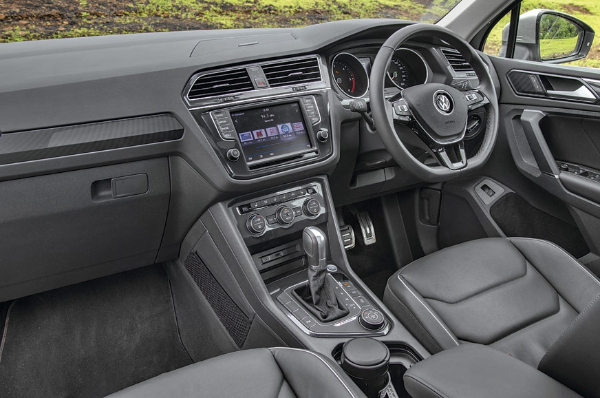 Tiguan's all-black cabin uses high-quality materials and ...