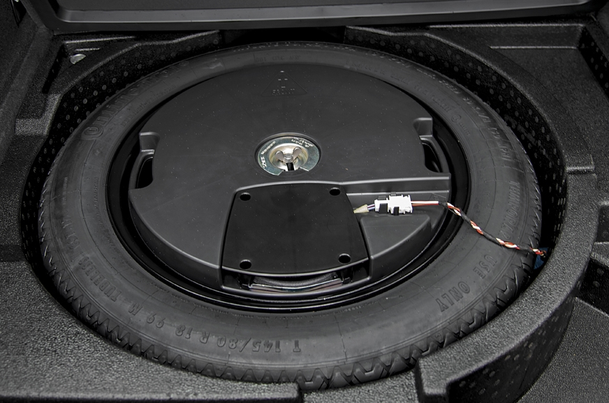 The Q3's spare wheel is smartly housed under the floor of...