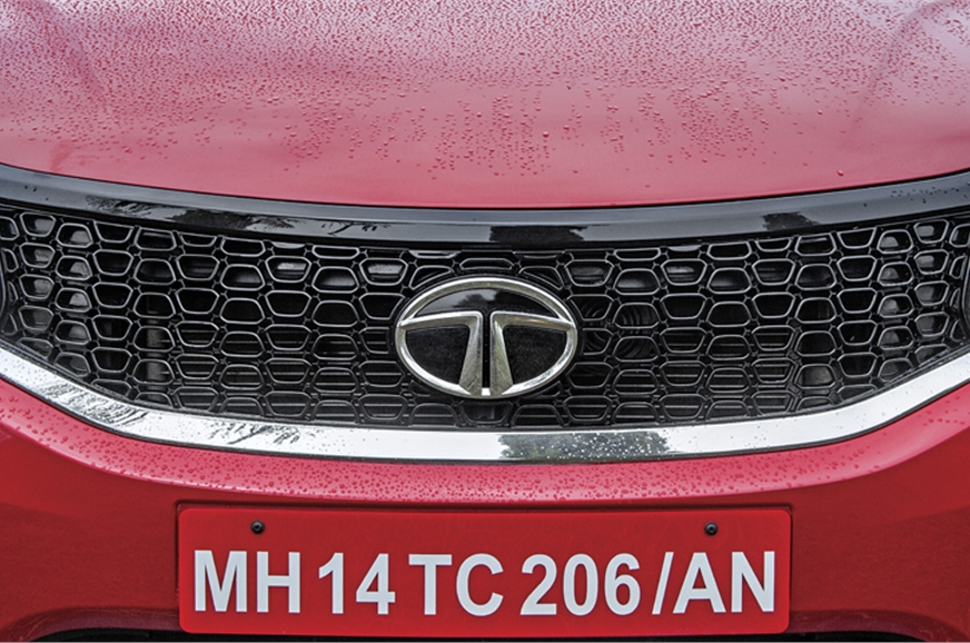 Chrome band under blacked-out grille helps enhance visual...