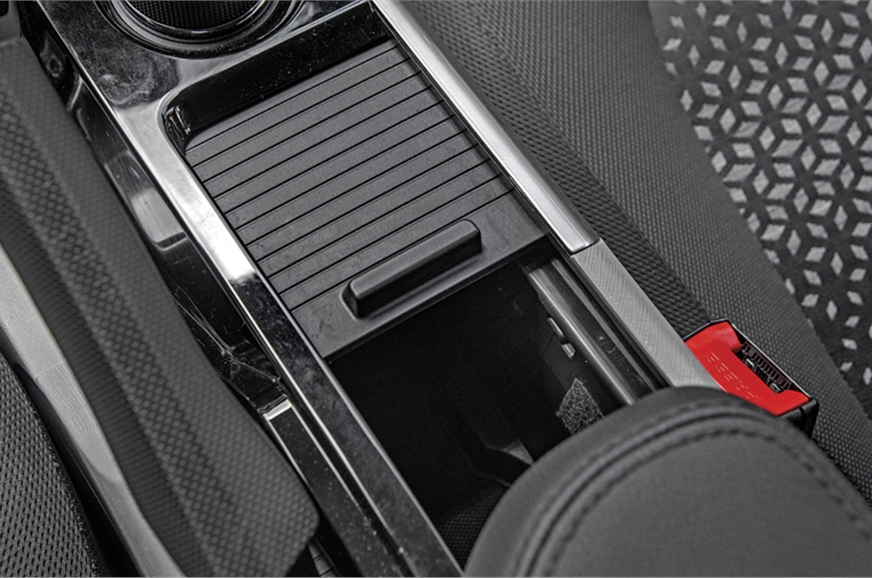 Shutter-like opening for the centre storage box is a deta...