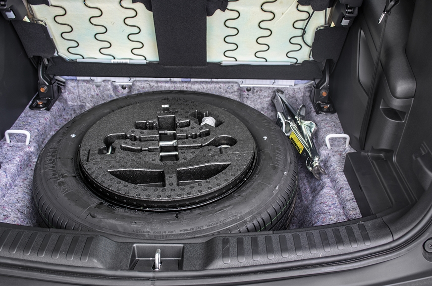 Full-size spare tyre fits neatly under the third row.
