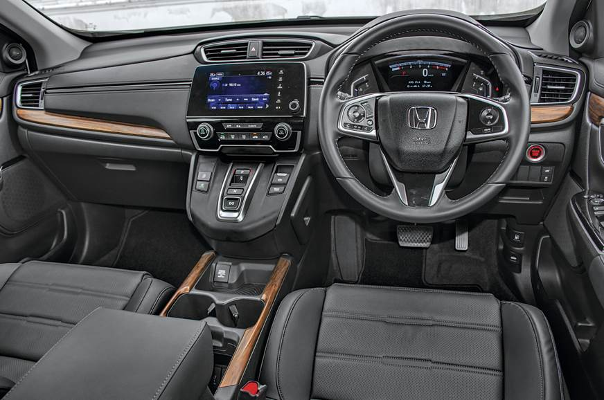 The new push-button gear selector dominates the cabin.