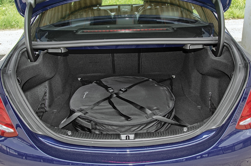 Merc's spare takes up much of the boot space.