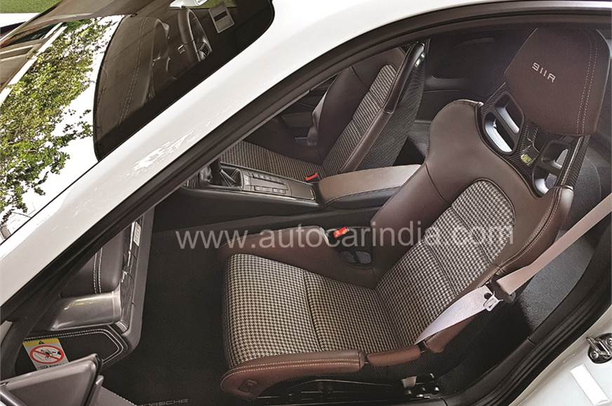 'Houndstooth' patterned, one-piece carbon bucket seats do...