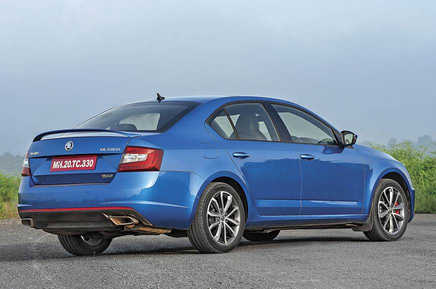 Few sporty bits on the sides and rear, but the exhausts a...
