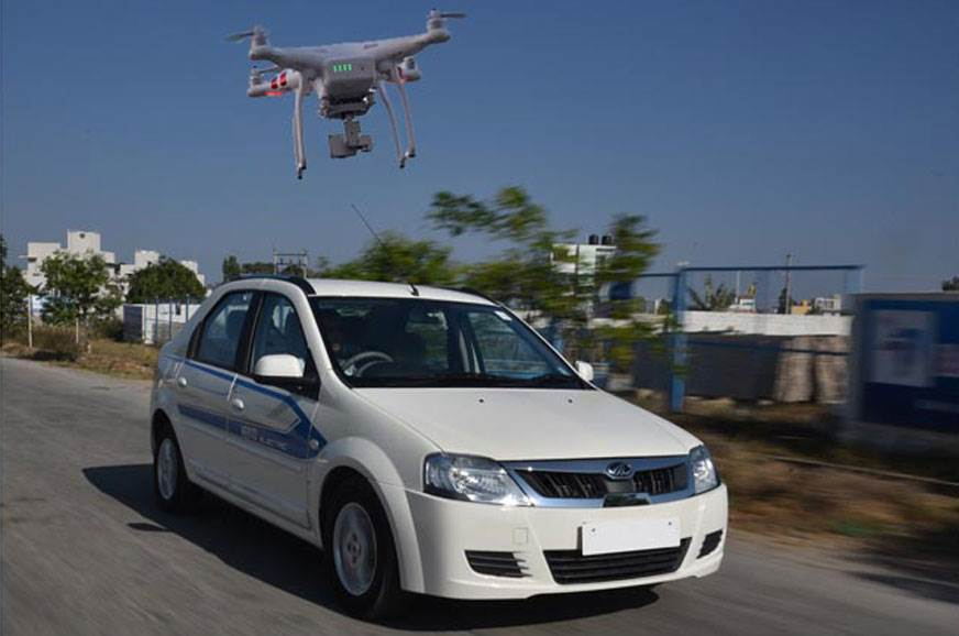 Representative image of a drone charging an EV.