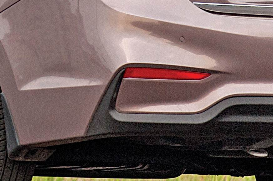 Boot lid lip and ridges on bumper help reduce air flow re...