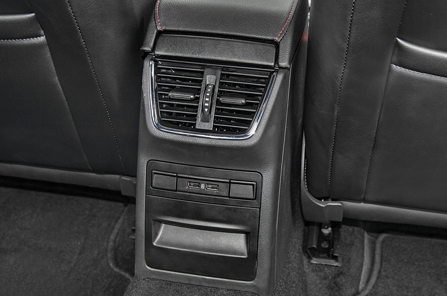 The sporty sedan also gets several practical features lik...