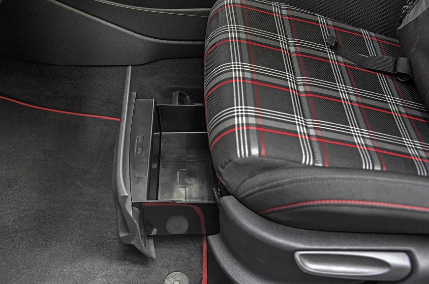 The GTI gets some smart bits like underseat storage tray.