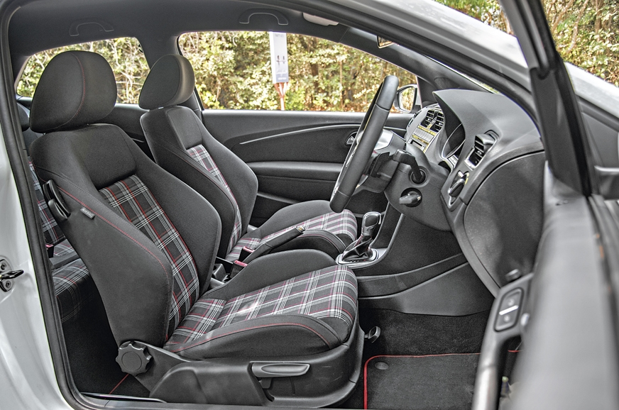 The GTI's sporty front seats are very supportive while dr...