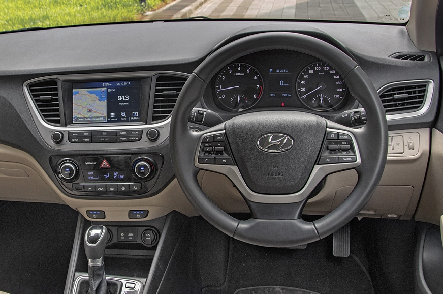 Hyundai's dash is neat and its low sill allows great view...