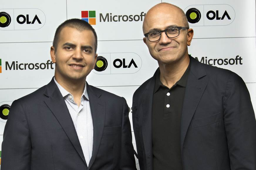 Bhavish Aggarwal, co-founder, Ola (L) & Satya Nadella, CE...