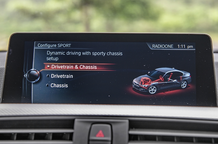 No touchscreen on the BMW, but iDrive by far the better s...