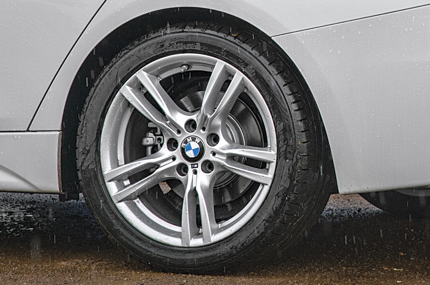 330i gets 18in wheels; rear tyres wider than front's.