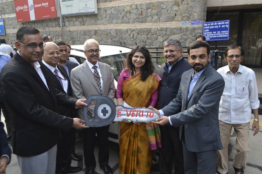 Mahesh Babu, CEO, Mahindra Electric handing over the keys of the Mahindra e-Verito to Saurabh Kumar, MD, EESL in the presence of Ajay Kumar Bhalla, Secretary, Ministry of Power and others.