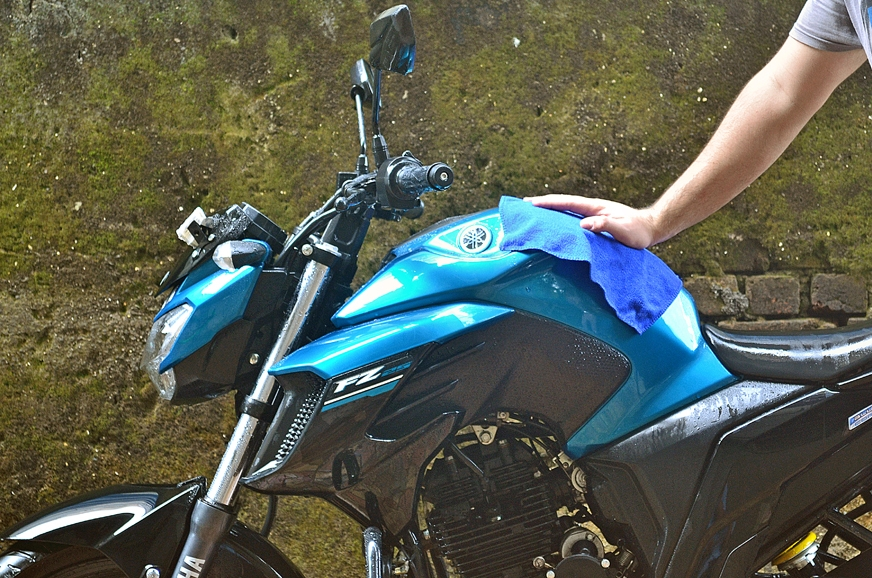 Drying off the motorcycle with another microfiber cloth.