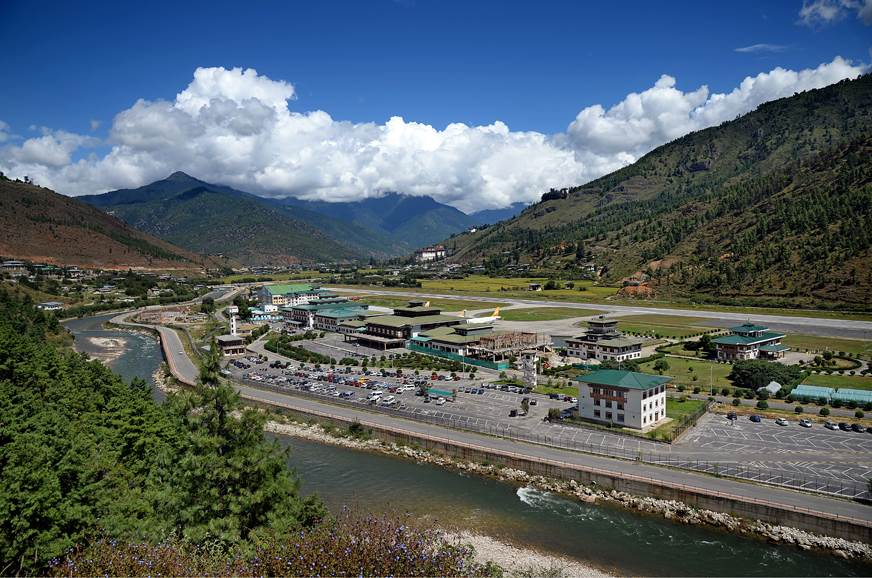 The quaint Paro airport makes for a pretty picture in the...