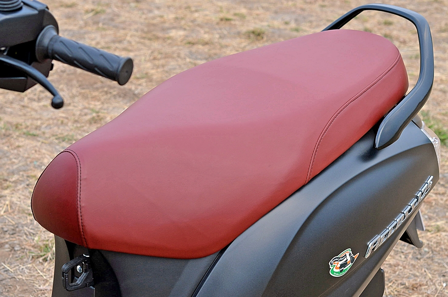 The Access 125's seat is flatter, roomier than the Grazia...
