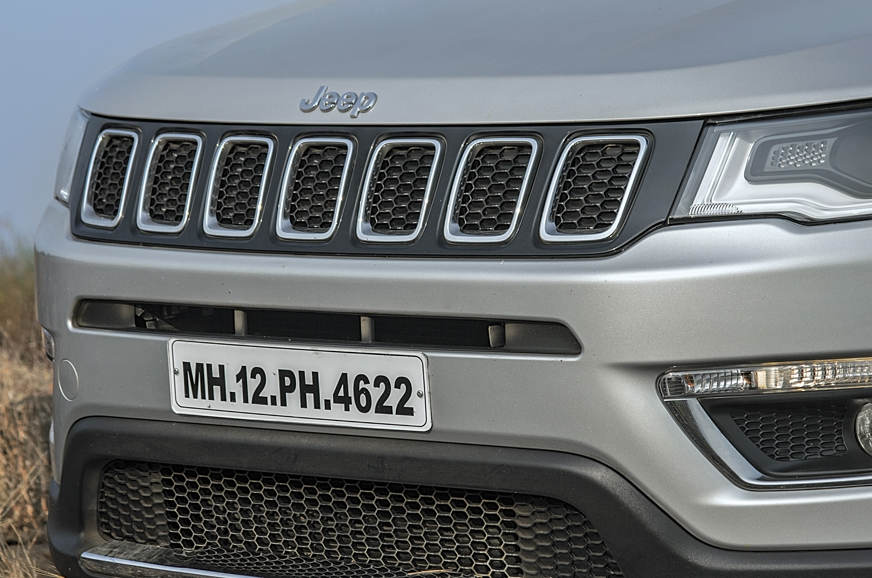 Seven-slat grille is trademark Jeep. Functional air inlet...