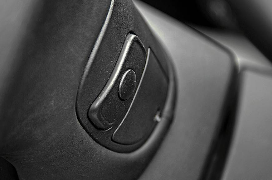 Driver's audio controls are positioned on the back of the...