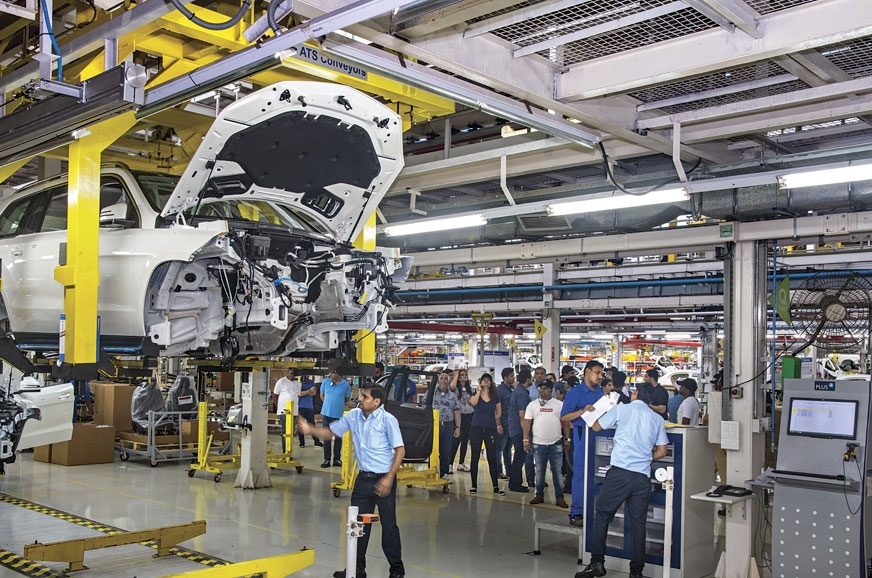 Guests are taken on a guided tour of the Mercedes assembl...