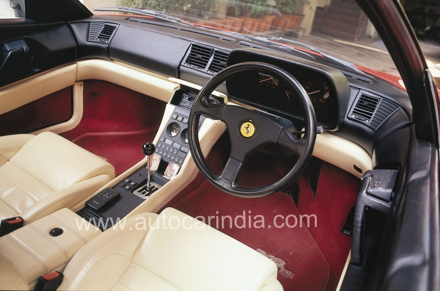 While 348 GTS's driving position is comfortable, the peda...