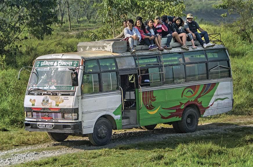 Adventurous GODs enjoy an unplanned bus-top ride in Chitw...