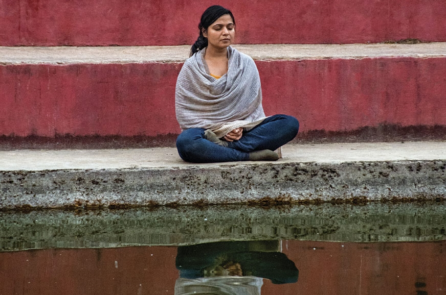 A GOD in a rare moment of peace and reflection at Lumbini.
