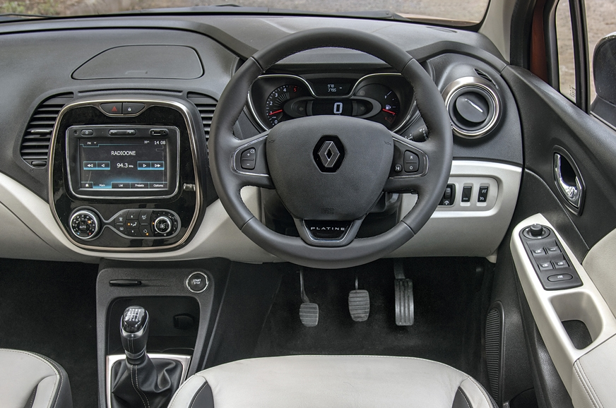 Captur's layered dashboard is attractive but hard plastic...