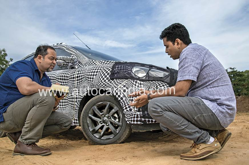 Sarosh Soman (right) discusses steering weight and feel.