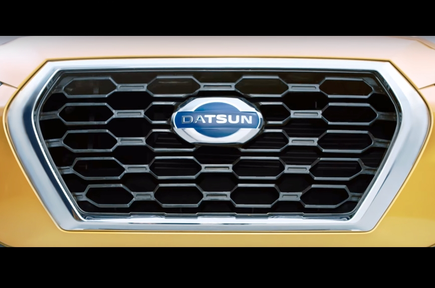 New honeycomb grille gets chrome border.