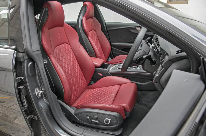 Some will find the Audi's front seats snug.