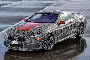 BMW 8-series officially revealed in light camouflage