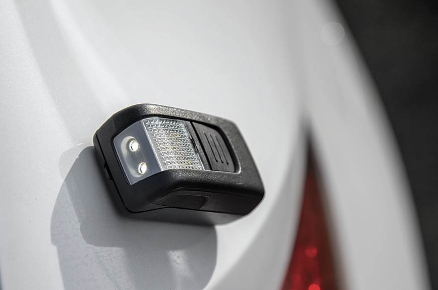 Mini LED torch can be detached from boot and attached mag...
