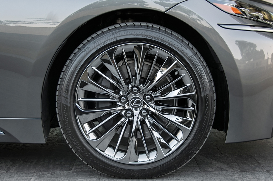 Chromed-over 20-inch rims give the car the requisite bling.