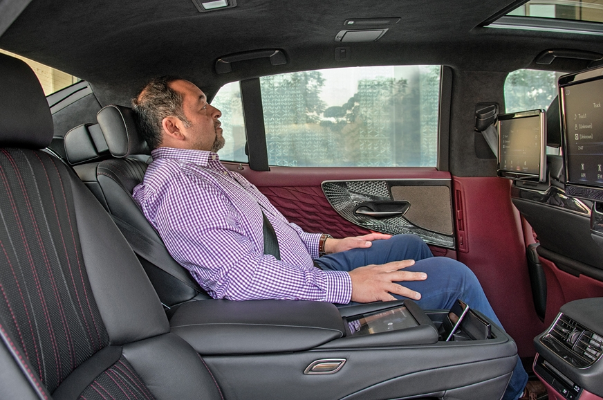 Rear seat reclines to 48 deg, with a foot support popping...